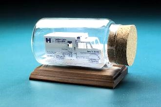 Ambulance sculpture made from business cards. Gift idea for emergency crews.