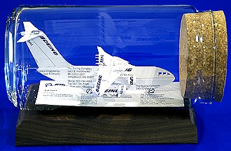 C-17 Globemaster sculpture made from business cards.