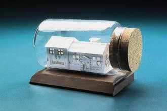 gift for real estate agents - house sculpture made from business cards